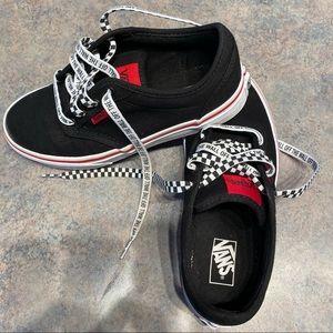 Black Vans low top sneakers